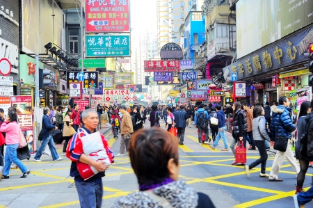Hong Kong - January 19, 2013: People taking а shopping at Mongkok district in Hong Kong. For companies, there is a 17.5% corporate tax in Hong Kong, which is lower than international standards.