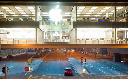 Hong Kong - January 21, 2013:  Apple store at night in Hong Kong. In 2012, Apple sold 172 million iPods, iPhones and iPads, These post-PC devices making up a total of 76-percent of Apples revenue.