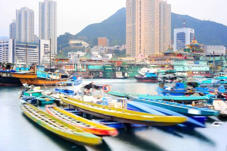 lake dweller: Aberdeen is famous to tourists for its floating village and floating seafood restaurants. Hong Kong Stock Photo