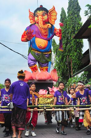 Ubud, Bali, Indonesia - March 12, 2013: Unidentified people taking part in celebration of Nyepi - Balinese Day of Silence . The day following Nyepi is also celebrated as New year.