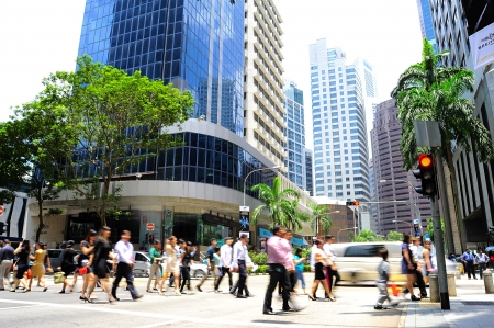 Singapore, Republic of Singapore - March 07, 2013: Unidentified businessmen crossing the street on March 07, 2013 in Singapore. There are more than 7,000 multinational corporations from United States, Japan and Europe in Singapore.