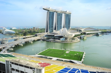 Aerial view on Marina Bay Floating Platform, Marina Bay Sands resort and Garden by the Bay in Singapore