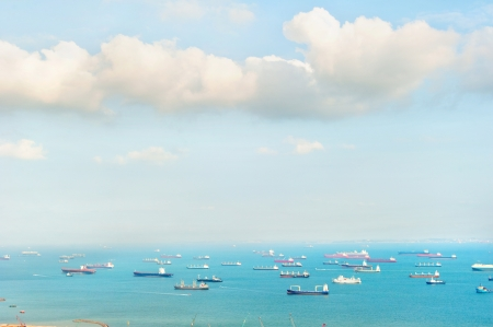 cargo vessel: A lot of ships in the Singapore harbor Stock Photo