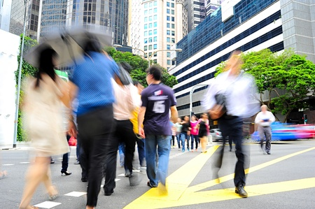 busy street: Unidentified businessmen crossing the street in Singapore. There are more than 7,000 multinational corporations from US States, Japan and Europe in Singapore