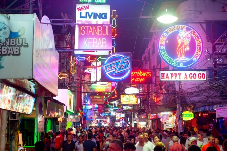 Pattaya, Thailand - February 20, 2013: Unidentified people on a Walking Street in Pattaya. Walking Street is a popular tourist attraction. Almost 20 million tourists visited Thailand in 2012.