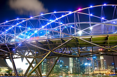tonnes: Singapore, Republic of Singapore - March 06, 2013: The Helix Bridge at night in Singapore. Its a bridge in the Marina Bay. The Helix is fabricated from 650 tonnes of Duplex Stainless Steel and 1000 tonnes of carbon steel.