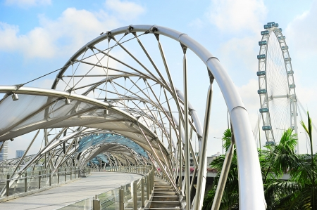 double helix: Singapore, Republic of Singapore - March 08, 2013: The Helix Bridge in Singapore. Is a bridge in the Marina Bay. The Helix is fabricated from 650 tonnes of Duplex Stainless Steel and 1000 tonnes of carbon steel. Editorial