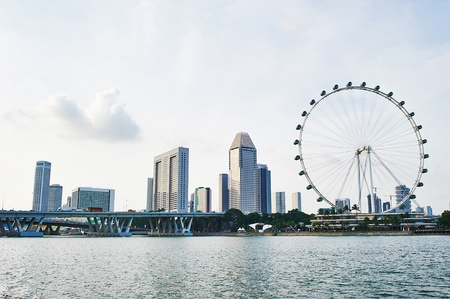 observation wheel: Skyline of Singapore with Flyer and modern buildings Stock Photo