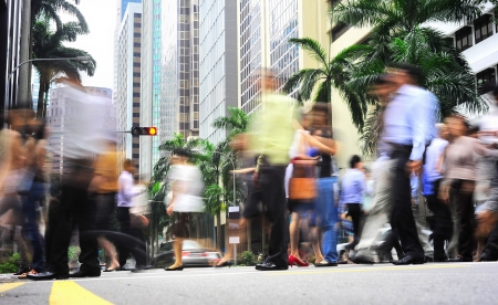 Unidentified businessmen crossing the street in Singapore  There are more than 7,000 multinational corporations from US States, Japan and Europe in Singapore Editorial