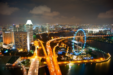 singapore building: Aerial view of Singapore with Singapore Flyer in the right corner