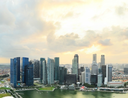 Aerial view of Singapore downtown with moody sunset sky photo