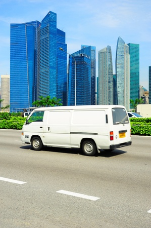 White minibus on the road in Singapore  Blured motion photo