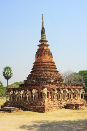 Elephants and brick pagoda in old Sukhothai, Thailand photo