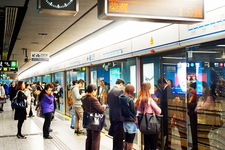 reportedly: Hong Kong, Hong Kong S.A.R. - January 21, 2013: Unidentified people waiting for a subway train . In 2012 the MTR reportedly had 46.4% of the public transport market, making it the most popular transport in Hong Kong. Editorial