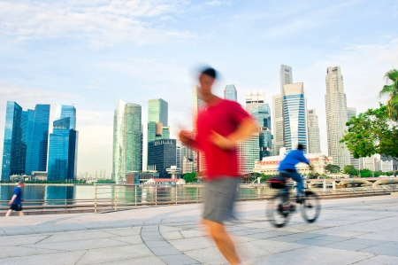 runing: People runing and cycling in the morning in Singapore