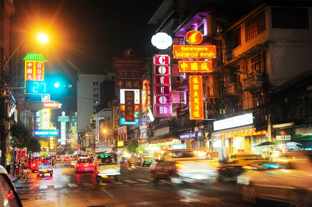chinatown: Bangkok, Thailand - March 03, 2013: Busy Yaowarat Road in the evening in Bangkok. Yaowarat Road is a main street in Bangkoks Chinatown,  was opened in 1891 in the reign of King Rama V.