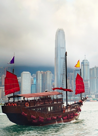 Famous traditional  sailboat sailing in Hong Kong harbor photo