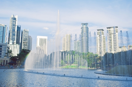 Central park in Kuala Lumpur, fountains in front of Petronas Twin Towers photo