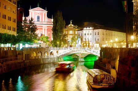 ljubljana: Triple Bridge and Franciscan Church at night  Ljubljana, Slovenia