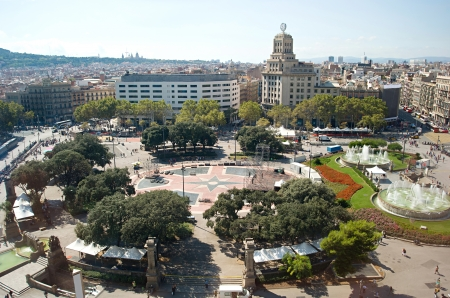 Busy day on Central Square in Barcelona, crowds of tourists in the midday photo