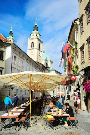 Ljubljana, Slovenia - September 2, 2013: People at street cafe in old town of Ljubljana, Slovenia. This year the city of Ljubljana is competing for the title of European Green Capital 2016