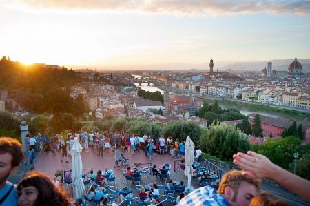 declared: Florence, Italy - September 10, : Tourist looking at Florence from the viewpoint. The historic centre of Florence declared a World Heritage Site by UNESCO in 1982