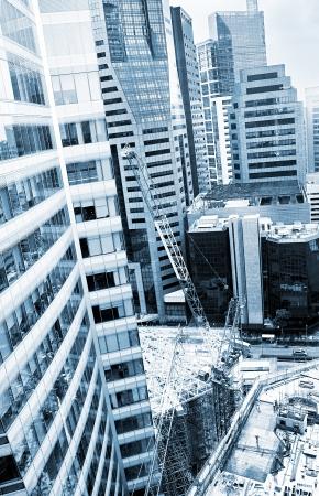 Construction site of a modern skyscraper in Singapore photo