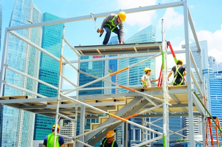 Singapore, Republic of Singapore -  May 09, 2013  Workers at construction site in front of Singapore downtown on in Singapore  Construction industry is expected to pull in some S 30 billion this year Editöryel