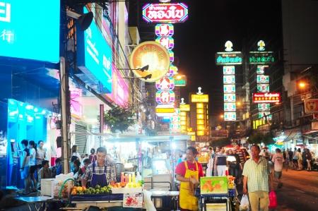 main market: Bangkok, Thailand - March 03, 2013  People at Yaowarat Road in the evening in Bangkok  Yaowarat Road is a main street in Bangkok Editorial