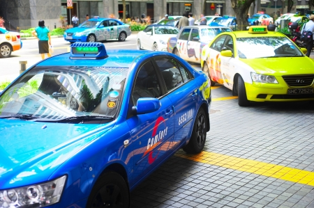 Singapore, Republic of Singapore -  March 08, 2013   Taxi cabs on the road in Singapore  The government will spend SGP 14 billion to improve Singapore Editöryel