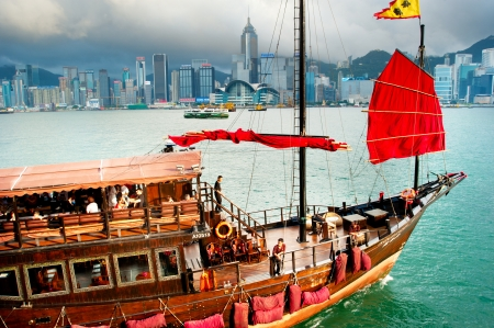 Hong Kong - May18, 2013  Traditional chinese-style tourist junk sailing in Hong Kong harbor   Overall visitor arrivals to Hong Kong in 2012 totalled just over 38 million, a 24  increase over the previous year