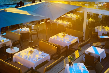Top view on the restaurant in sunset lights, Cannes photo
