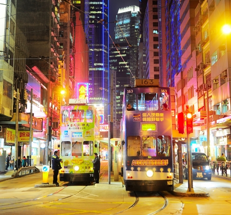 Hong Kong S A R  - January 14, 2013  Trams on the street  in Hong Kong  Trams in Hong Kong have not only been a form of transport for over 100 years, but also a major tourist attraction   Editoriali