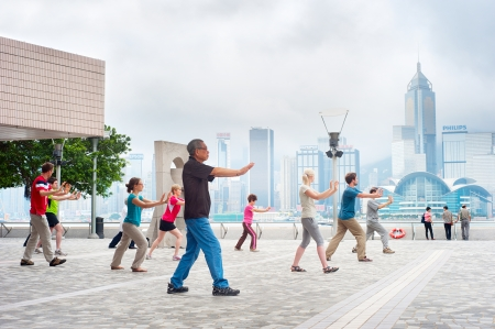 Hong Kong S.A.R. - May 15, 2013: Tai Chi Public Exercising in early morning  in Hong Kong. With a land of 1,104 km and population of 7 million, Hong Kong is one of the most densely populated areas in the world