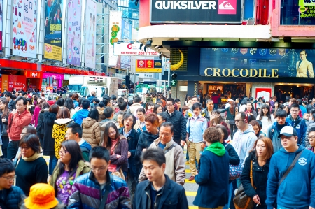Hong Kong S.A.R. - Jan 19, 2013: Shoppers and visitors crowd at a shopping street on Jan 19, 2013 in Hong Kong. With a land of 1,104 km and population of 7 million, Hong Kong is one of the most densely populated areas in the world 報道画像
