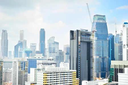 Skyline of Singapore downtown with a construction site on foreground photo