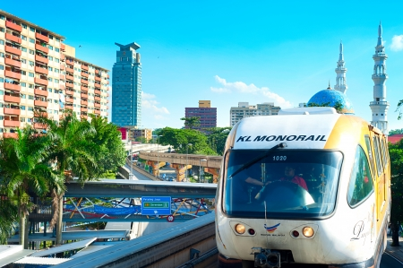 arrives: KUALA LUMPUR - MAY 13, 2013: Monorail train arrives at a train station in Kuala Lumpur, Malaysia. Kuala Lumpur metro consists of 6 metro lines operated by 4 operators. Editorial