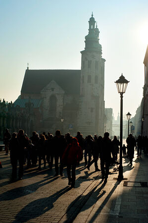 crowded street: Crowded street and St. Andrews Church in the sunshine day, Kraków Editorial