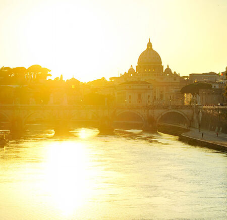 pietro:  View of Tiber and St. Peters cathedral at sunset in Rome  Stock Photo