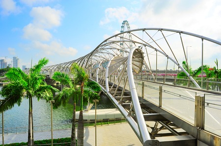 tonnes:  The Helix Bridge in Singapore. Is a bridge in the Marina Bay. The Helix is fabricated from 650 tonnes of Duplex Stainless Steel and 1000 tonnes of carbon steel  Stock Photo