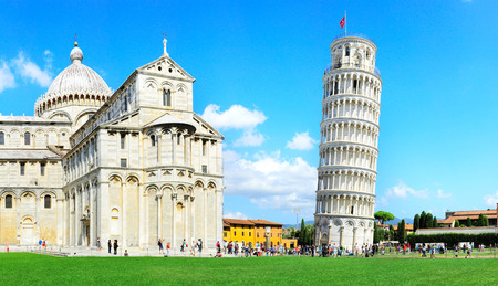 Tourist visiting the leaning tower of Pisa , Italy  Редакционное