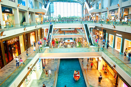 SINGAPORE - MARCH 08, 2013 : Shopping mall at Marina Bay Sands Resort in Singapore. It is billed as the worlds most expensive standalone casino property at S$8 billion