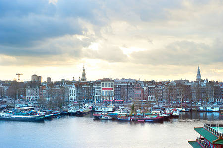 Skyline of Amsterdam at colorful dusk. Aerial view photo
