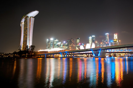 marina bay sand: Skyline of Singapore at night with colorful neon lights