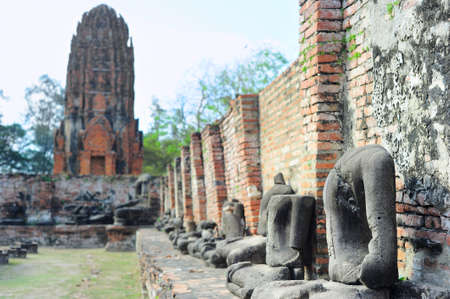 A row of Buddha statues without head in Ayutthaya historical park, Ayutthaya , Thailand  photo