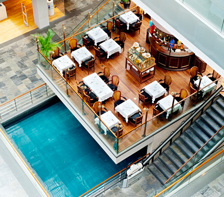 standalone: SINGAPORE - MARCH 07, 2013: Restaurant at Marina Bay Sands Resort in Singapore. It is billed as the worlds most expensive standalone casino property at S$8 billion