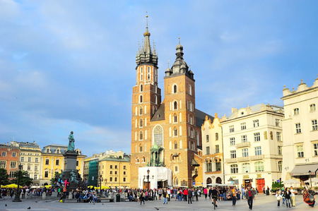 KRAKOW, POLAND - AUGUST27, 2013: Tourists at the Market Square in Krakow . Main Market Square, one of the largest medieval squares in Europe, was built in 1257.