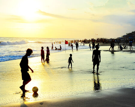 adult indonesia: people plaing soccer in Kuta, Bali island, Indonesia.  Editorial