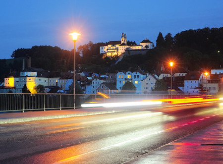 Road with colorful reflection of a car lamps. Regensburg, Germany photo