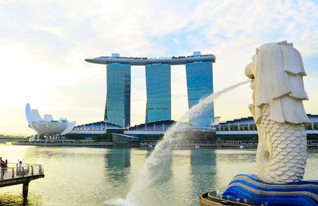 SINGAPORE - MAY 09, 2013 The Merlion fountain in front of the\ Marina Bay Sands hotel in Singapore. Merlion is a imaginary\ creature with the head of a lion, seen as a symbol of Singapore\